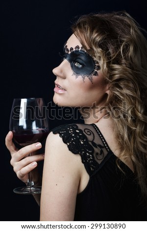 Beauty Girl with a glass of wine.Fashion Art Woman Portrait with fashion mask makeup - stock photo