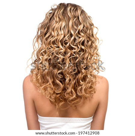 Beauty girl with blonde curly hair. Healthy and long Blond Wavy hair. Long permed hair. Beautiful young woman. Backside. Rear view  - stock photo