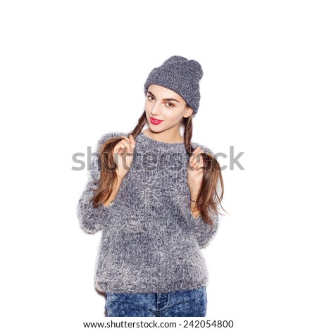 Beauty girl with bright make-up holding her two braids. White background, not isolated - stock photo