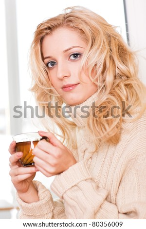 beauty girl with cup in her hand