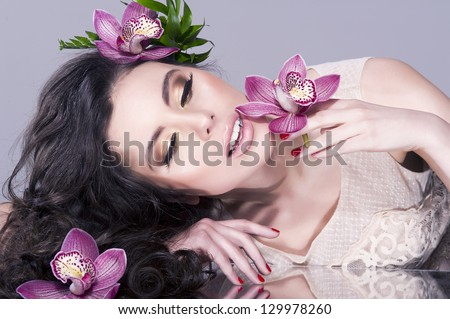 Beauty Girl With  Flowers .Beautiful Model Woman Face - stock photo