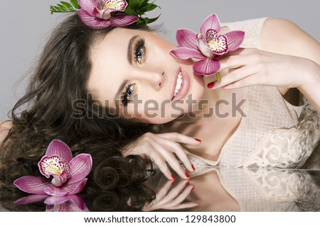 Beauty Girl With  Flowers.Beautiful Model Woman Face. Perfect Sk - stock photo