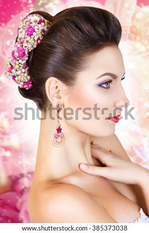 Beauty Girl With Flowers.Beautiful Model Woman Face. Perfect Skin. Professional Make-up.Makeup. Fashion Art - stock photo