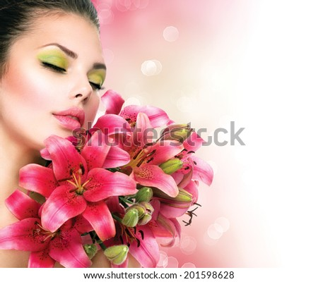 Beauty Girl with Lilly Flowers bouquet. Beautiful Model woman with Blooming pink lily flowers. Nature. Summer. Holiday Creative Makeup. Fashion Make up. Spa woman Portrait - stock photo