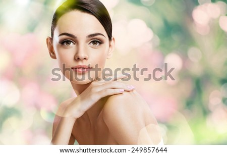 Beauty girl with make up face / photoset of attractive brunette girl on blurred background with bokeh  - stock photo