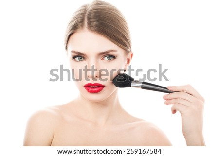 Beauty Girl with Makeup Brush. Beautiful Face. Makeover. Perfect Skin. Applying Makeup  - stock photo