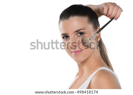 Beauty Girl with Makeup Brush. Brunette Woman with Brown Eyes. Beautiful Face. Perfect Skin. Applying Makeup
