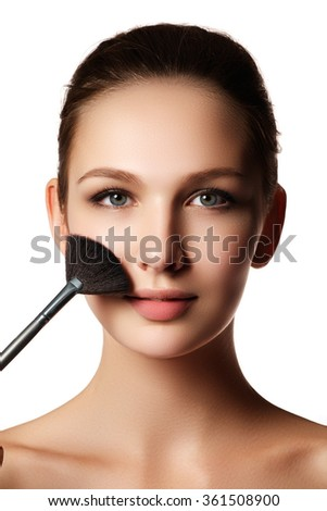 Beauty Girl with Makeup Brushes. Natural Make-up for Brunette Woman with blue Eyes. Beautiful Face. Makeover. Perfect Skin. Applying Makeup