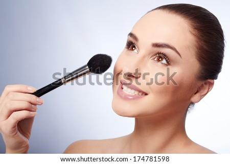 Beauty Girl with Makeup Brushes. Natural Make-up for Brunette Woman with Brown Eyes.
