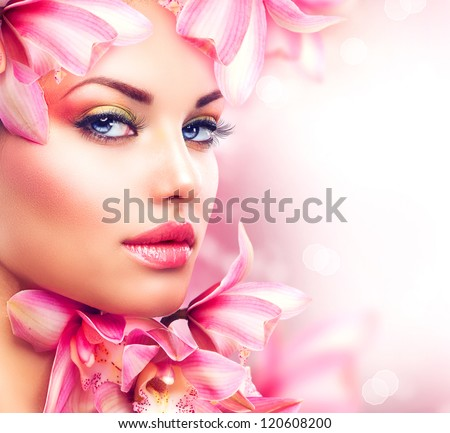 Beauty Girl With Orchid Flowers.Beautiful Model Woman Face. Perfect Skin. Professional Make-up.Makeup. Fashion Art - stock photo