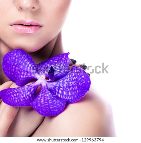 Beauty girl with orchid flowers.Beautiful Woman Face. Professional Makeup.Isolated on white - stock photo