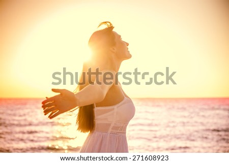 beauty girl with outstretched arms on the sea