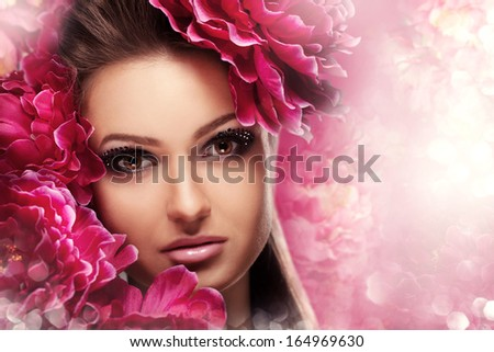 Beauty Girl With peonies Flowers. Beautiful Model Woman Face. Perfect Skin. Professional Make-up.Makeup. Fashion Art - stock photo