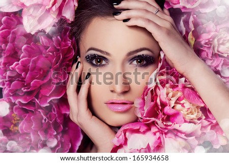 Beauty Girl With peonies Flowers.Beautiful Model Woman Face. Perfect Skin. Professional Make-up.Makeup. Fashion Art - stock photo