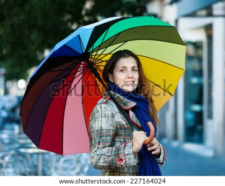 beauty girl with umbrella  in autumn street - stock photo