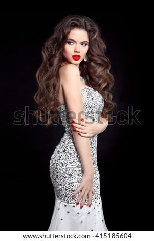 Beauty. Hair. Brunette bride in wedding dress. Elegant lady with makeup and long wavy hairstyle.  Beautiful girl model in fashion beaded Sequins gown isolated on black studio background.  - stock photo