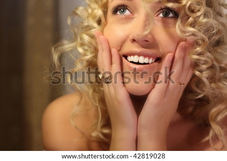 beauty happy blond  girl with white healthy teeth laughs