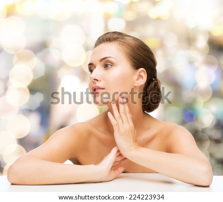 beauty, health and people concept - smiling beautiful woman with clean perfect skin over lights background - stock photo