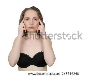 Beauty, health, make up and skin care concept - Young woman makes facial massage isolated on white background with copy space for advertising text - stock photo