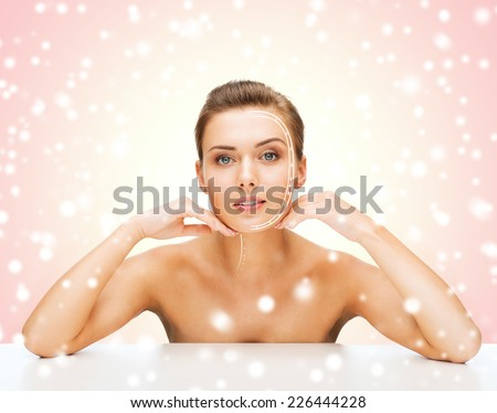 beauty, health, people and medicine concept - beautiful young woman with lines on face over pink snowy background - stock photo