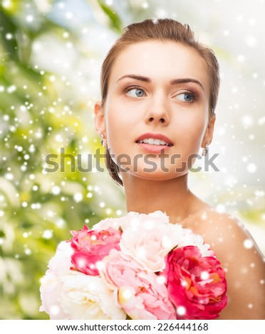 beauty, holidays, people and jewelry - woman with diamond earrings, ring and flower - stock photo