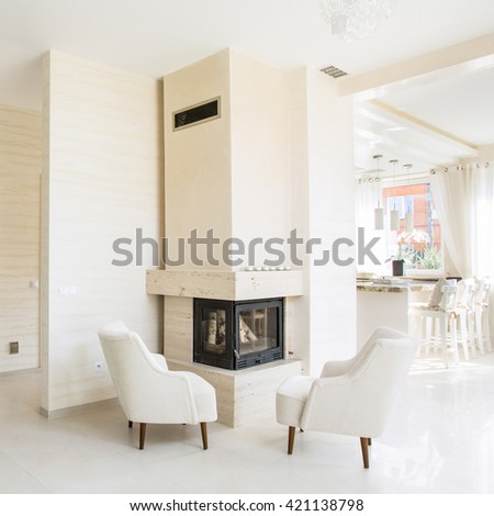 Beauty home in elegant style with fireplace - stock photo