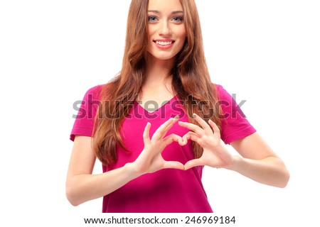Beauty in love. Happy young women keeping hands in a shape of heart while standing against white background - stock photo