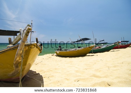 Beauty in nature,fisherman boat stranded on deserted sandy beach under bright sunny day.