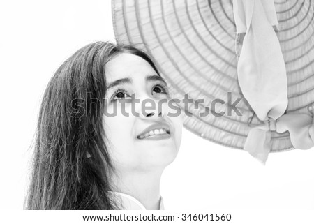 Beauty in the faces of young Vietnamese girls with big round eyes, bushy eyebrows and long hair flowing graceful beauty created for Vietnamese women characterized Asians - stock photo