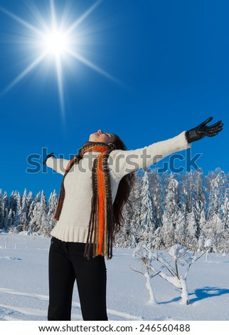 Beauty in warm clothes Midwinter Sunshine  - stock photo