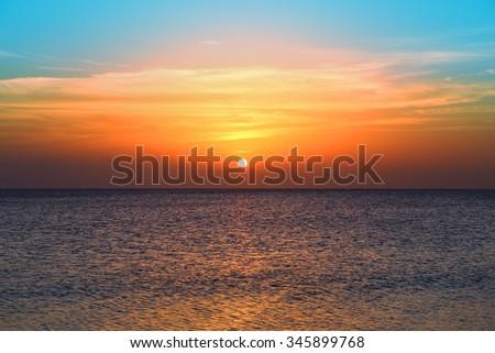 beauty landscape with sunrise over sea - stock photo