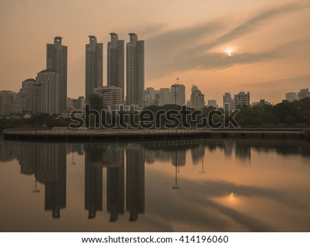 Beauty landscape with sunrise over the park at Bangkok, Thailand (Benchakitti Park)