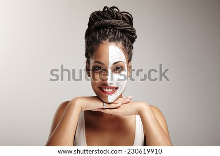 Beauty latin woman with a half of a face mask - stock photo