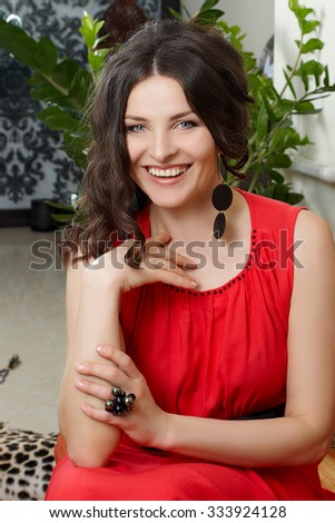 Beauty laughing woman indoors. Beautiful adult Model smiling. Happy elegant Woman.