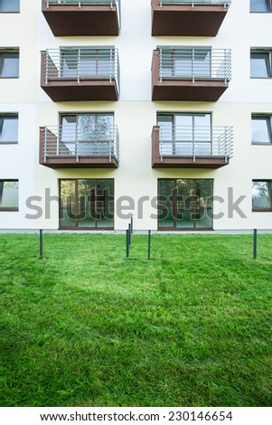 Beauty lawn in front of apartment building - stock photo