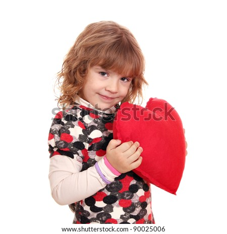 beauty little girl holding big red heart