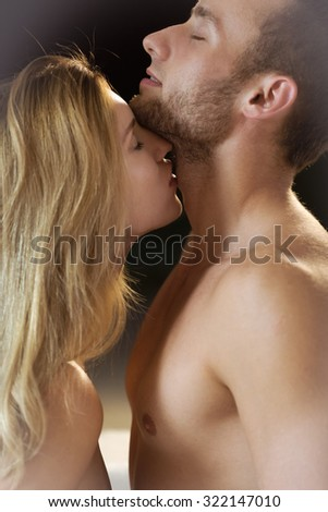 Beauty loving couple standing and kissing tenderly