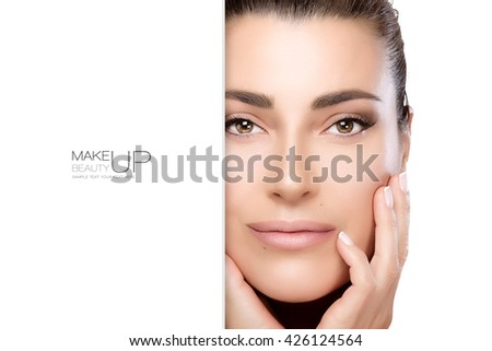 Beauty Makeup and Nai Art Concept. Beautiful fashion model woman with soft smoky eye makeup, foundation on a unblemished skin and trendy nude lipstick to match her manicured nails, closeup face. - stock photo