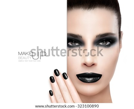 Beauty Makeup and Nail Art Concept. Beautiful brunette fashion model woman with black make-up. Trendy dark lips, black nail art and smoky eyes. High fashion portrait isolated on white with sample text - stock photo