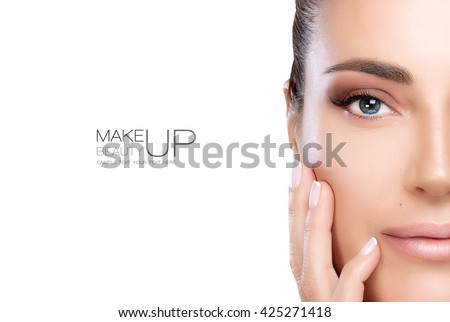 Beauty Makeup and Nail Art Concept. Beautiful fashion model woman with soft smoky eye makeup, foundation on a unblemished skin and trendy nude lipstick to match her manicured nails, half face isolated - stock photo