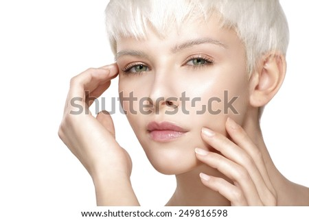 Beauty model blonde short hair showing perfect skin  on white - stock photo
