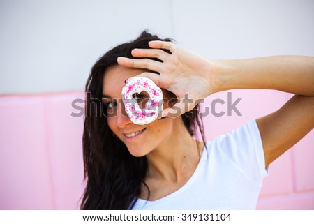 Beauty  model girl taking sweets and colorful donuts - stock photo