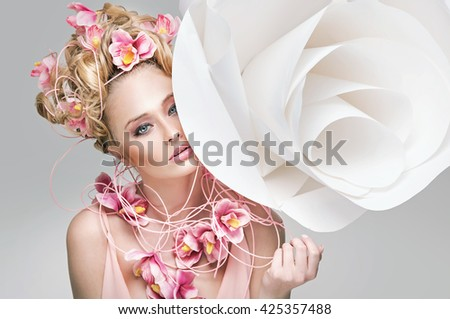 Beauty model girl with beautiful flowers in her hair - stock photo