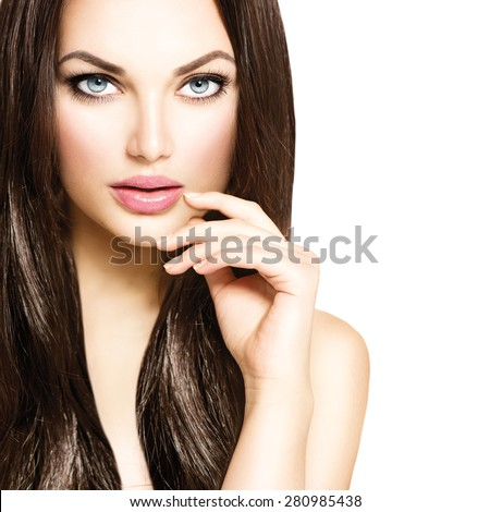Beauty Model girl with Healthy Brown Hair. Beautiful brunette woman touching her face. Makeup, Hairstyle. Hair cosmetics, haircare. Hair care, extensions - stock photo