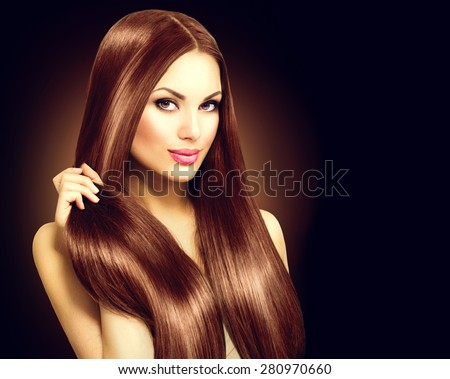 Beauty Model girl with Healthy Brown Hair. Beautiful brunette woman touching her long smooth shiny straight hair. Hairstyle. Hair cosmetics, haircare. Hair care, extensions - stock photo