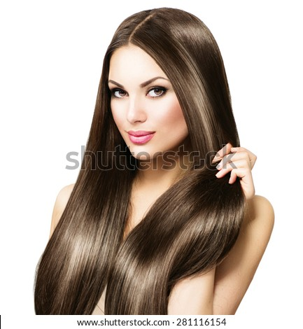 Beauty Model girl with Healthy Brown Hair. Beautiful brunette woman touching her long smooth shiny straight hair. Hairstyle. Hair cosmetics, haircare. Hair care, extensions. Isolated on white - stock photo