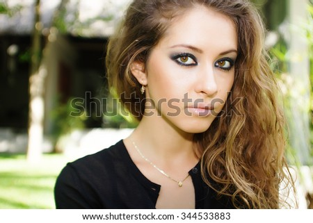 Beauty model girl with makeup in tropics