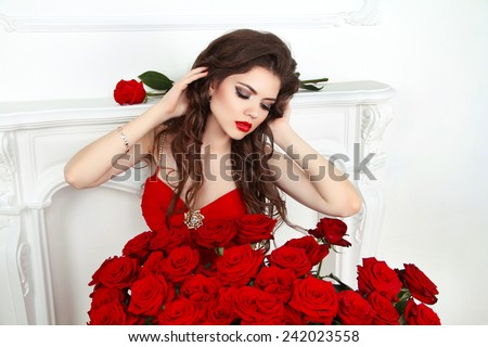 Beauty model girl with makeup, long hair and beautiful red roses bouquet. Fashion woman portrait. Valentines day.  - stock photo
