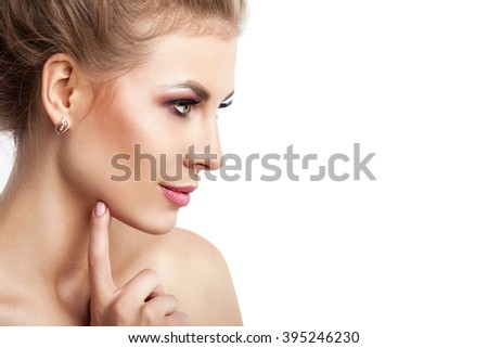 Beauty model girl with perfect make-up isolated over white. Portrait of attractive young woman with blond hair on white background. Beautiful female face with clear fresh skin. - stock photo