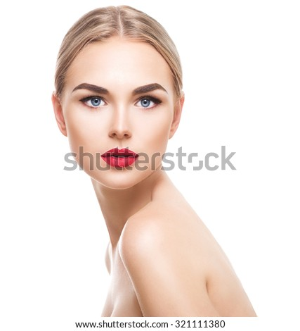 Beauty model girl with perfect make-up looking at camera isolated over white. Portrait of attractive young woman with blond hair on white background. Beautiful female face with clear fresh skin - stock photo